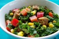Kale salade with tahini-miso dressing and baked tofu